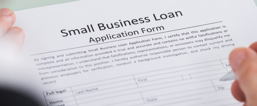 filling out a small business loan application